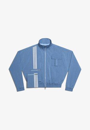 IVY PARK NYLON TRACK JACKET (ALL GENDER) - Sportovní bunda - light blue