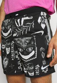 Nike Performance - WILD RUN - Sports shorts - black - 3
