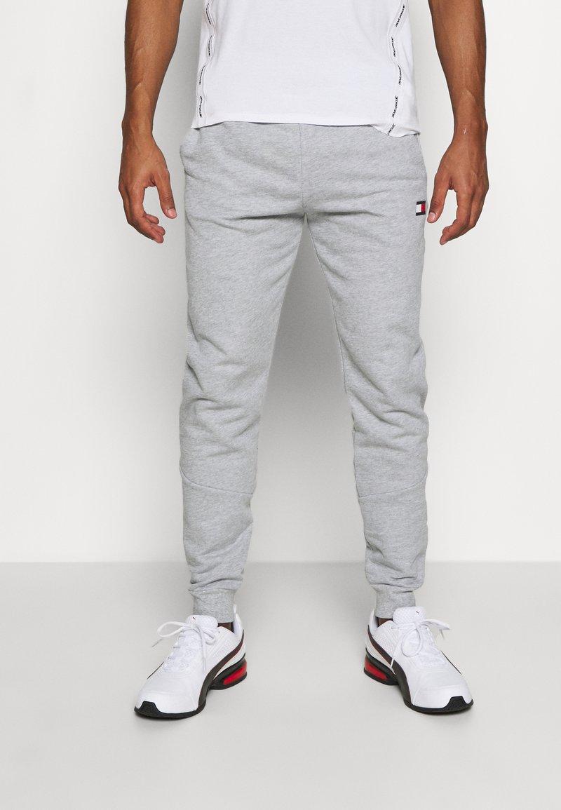 Tommy Hilfiger - CUFFED TAPE PANT - Pantaloni sportivi - grey
