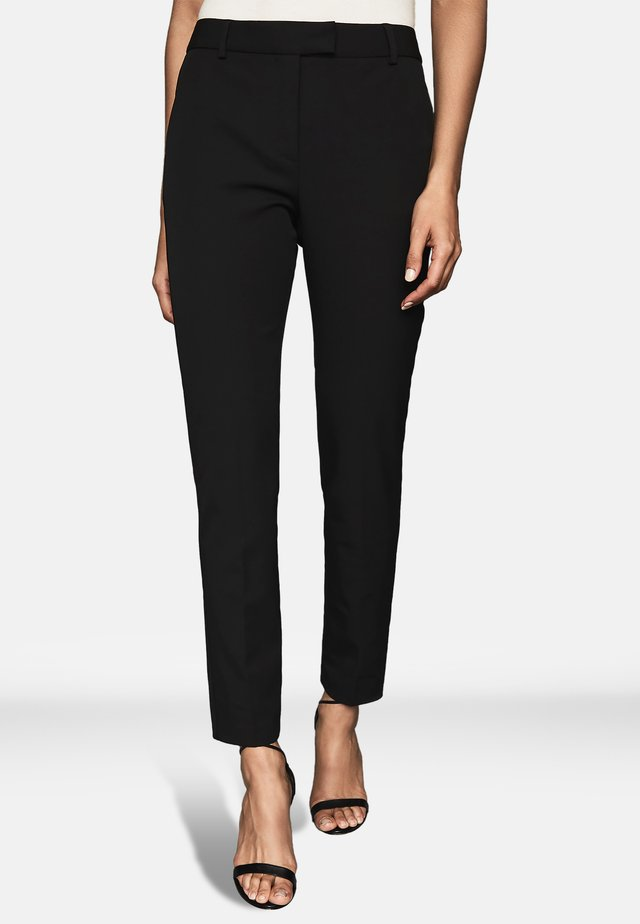 JOANNE - Trousers - black