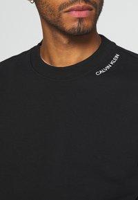 Calvin Klein - NECKLINE LOGO - Sweatshirt - black - 5