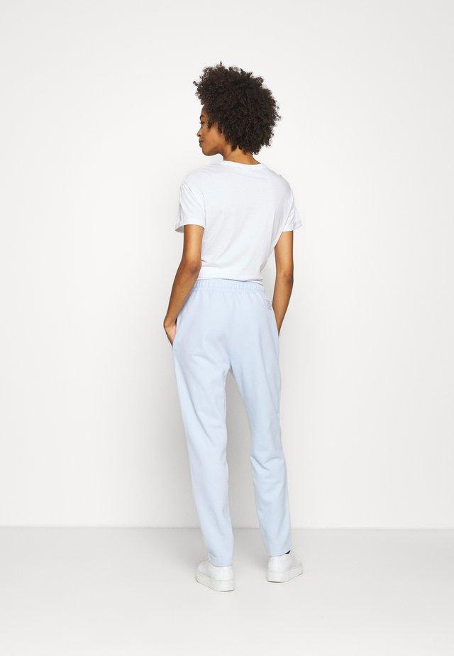 CINDY PANT - Spodnie treningowe - polished blue