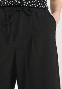 ONLY - ONLKIRAS LIFE CULOTTE PANTS - Trousers - black - 4