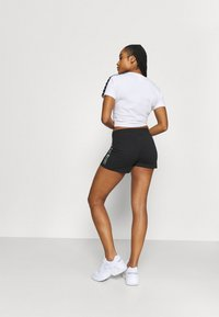 Champion - SHORTS - Urheilushortsit - black