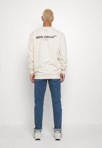 Calvin Klein Jeans - CKJ 026 SLIM - Jeans slim fit - mid blue - 2
