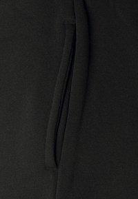 Even&Odd Petite - Tracksuit bottoms - black - 5