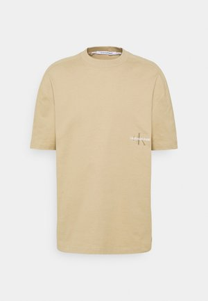 ICONIC TEE UNISEX - Print T-shirt - tan