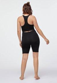 OYSHO - MATERNITY COMFORT - 3/4 sportovní kalhoty - black - 1