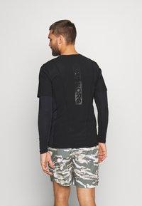 Björn Borg - AVERY TEE - Print T-shirt - black beauty - 2