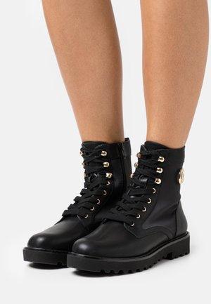 ANFIBIO - Šněrovací kotníkové boty - nero