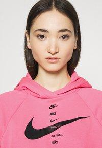 Nike Sportswear - HOODIE - Jersey con capucha - pink glow/black - 3