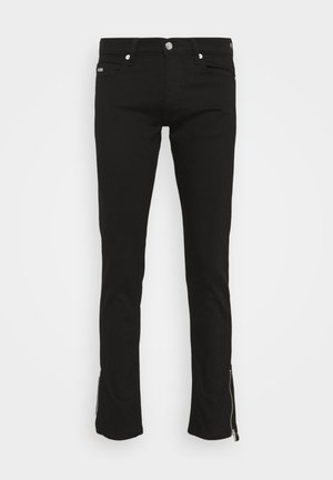 WASHED SLIM WITH ZIPPER DETAIL ON THE BOTTOM - Slim fit jeans - black