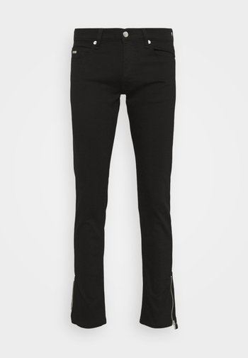 WASHED SLIM WITH ZIPPER DETAIL ON THE BOTTOM