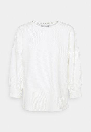 Long sleeved top - light creme