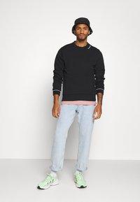 Calvin Klein - NECKLINE LOGO - Sweatshirt - black - 1
