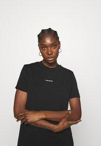 Calvin Klein Jeans - MICRO BRANDING DRESS - Jersey dress - black - 3