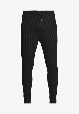 BUCK - Trousers - black