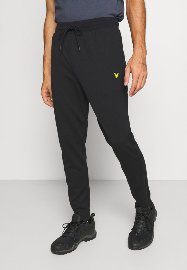 TECH TRACKIES - Verryttelyhousut - true black