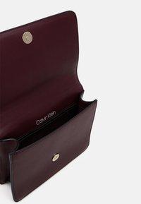Calvin Klein - FLAP SHOULDER BAG - Across body bag - brown - 2