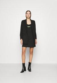 Calvin Klein Jeans - MILANO STRAPPY DRESS - Jersey dress - black - 1