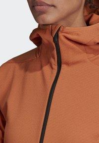 adidas Performance - TERREX CLIMAHEAT HOODED FLEECE - Fleece jacket - brown - 4