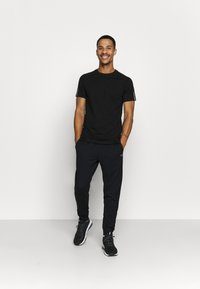 Calvin Klein Performance - PANTS - Pantaloni sportivi - black - 1