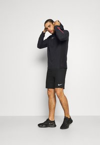 Nike Performance - Camiseta de deporte - black/white - 1