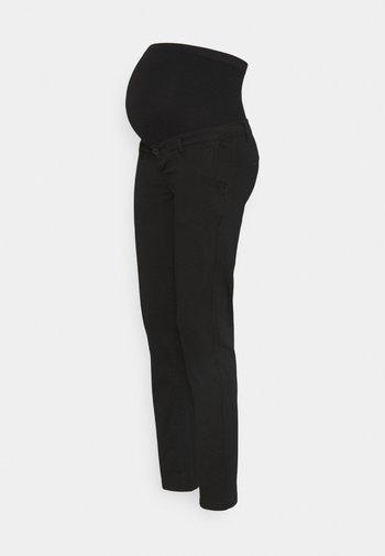 TONIO SEAMLESS - Trousers - black