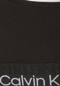 Calvin Klein Underwear - UNLINED TRIANGLE - Kaarituettomat rintaliivit - black - 6