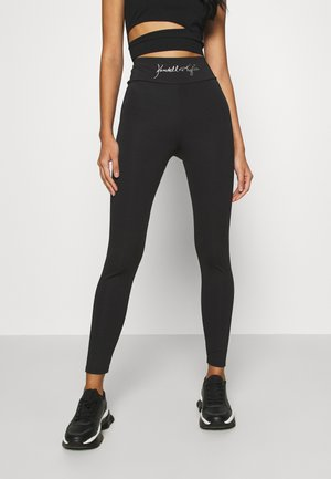 HIGH WAIST LOGOTIGHTS - Leggings - Trousers - black