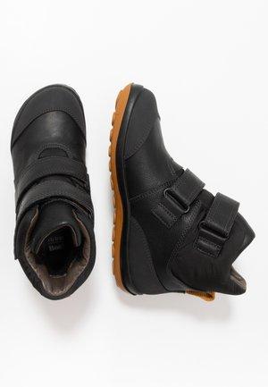PEU PISTA KIDS - Winter boots - black