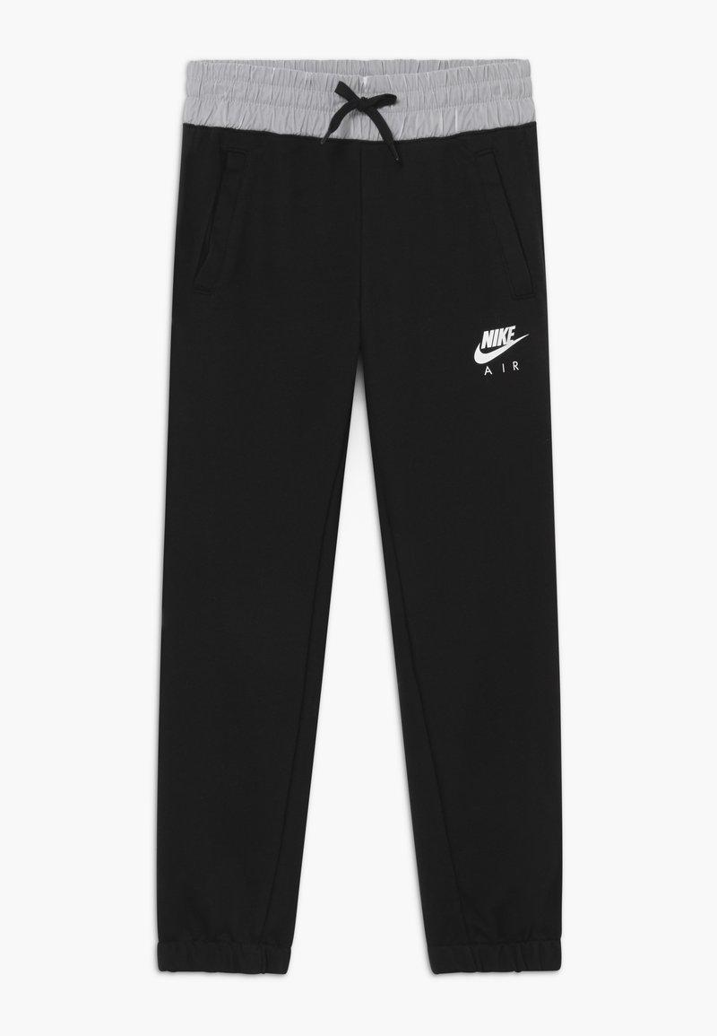 Nike Sportswear - Tracksuit bottoms - black/white
