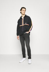 adidas Originals - TAPED ANORAK UNISEX - Windbreaker - black - 1