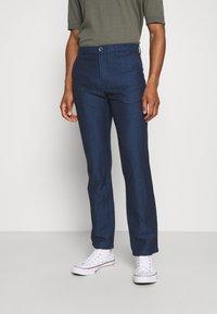 Tommy Hilfiger Tailored - DENTON HERRINGBONE - Trousers - desert sky - 0