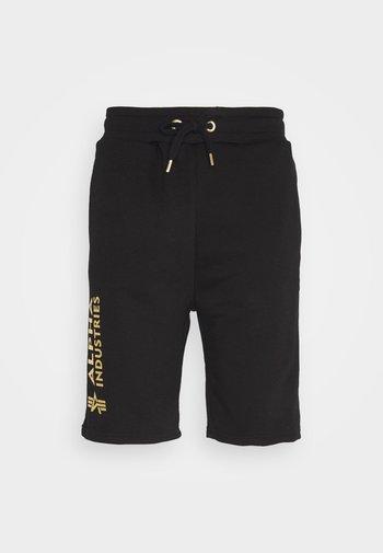 BASIC FOIL PRINT - Spodnie treningowe - black/yellow gold