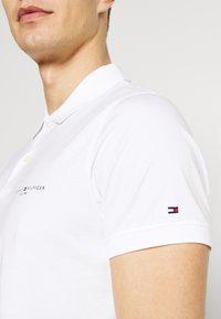 Tommy Hilfiger - CLEAN SLIM - Polo shirt - white - 4