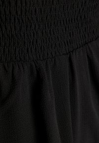 ONLY - ONLNOVA LUX SMOCK  - Falda plisada - black - 4
