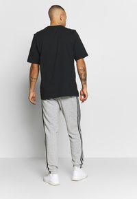 adidas Performance - ESSENTIALS 3STRIPES FRENCH TERRY SPORT PANTS - Tracksuit bottoms - medium grey heather/black - 2