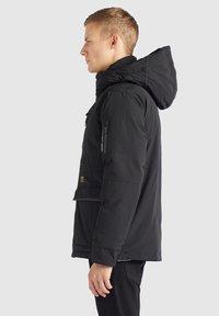 khujo - NANDU - Winter jacket - schwarz-schwarz kombo - 4