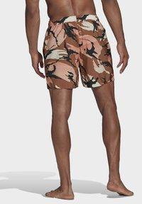 adidas Performance - SHORT-LENGTH GRAPHIC SWIM SHORTS - Swimming shorts - brown - 1