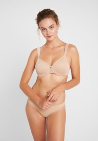 Triumph - TRUE SHAPE SENSATION - T-shirt bra - smooth skin - 1