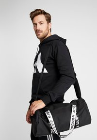 adidas Performance - ESSENTIALS 3 STRIPES SPORT DUFFEL BAG UNISEX - Sports bag - black/white - 1