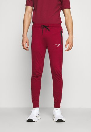 STATEMENT CLASSIC - Tracksuit bottoms - red