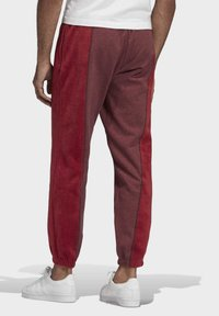 adidas Originals - R.Y.V. SWEAT JOGGERS - Tracksuit bottoms - red - 1