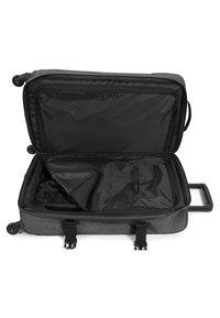 Eastpak - TRANS4 M CORE COLORS  - Wheeled suitcase - black denim - 4