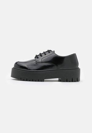 LINDON UP - Lace-up heels - black