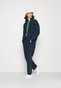 adidas Originals - UNISEX - Summer jacket - collegiate navy - 1