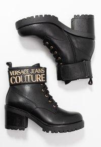 Versace Jeans Couture - Kotníková obuv - black - 3