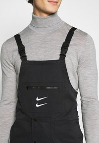 Nike Sportswear - OVERALLS - Stoffhose - black/white - 5