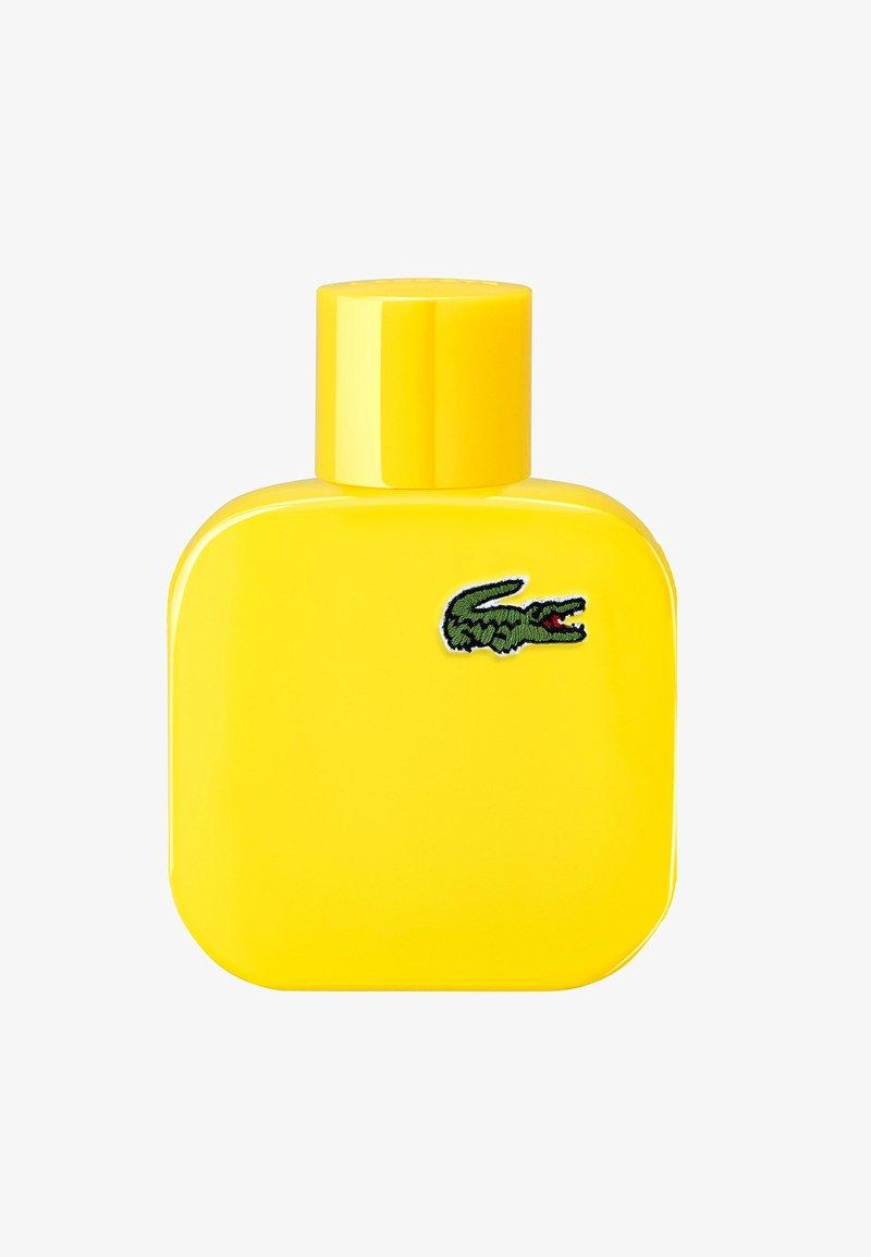 Lacoste Fragrances - EAU DE LACOSTE L.12.12 JAUNE EAU DE TOILETTE - Woda toaletowa - -